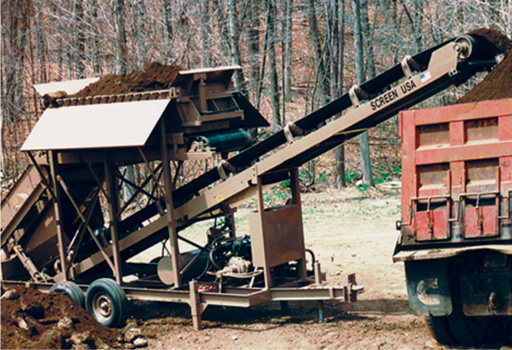 A BF35D2 easily loads a dump truck with its built-on conveyor