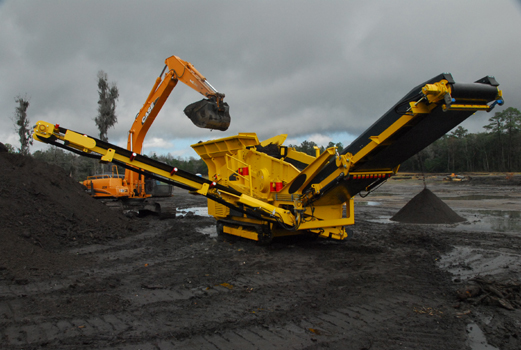 This CD409 is being loaded with an excavator bucket