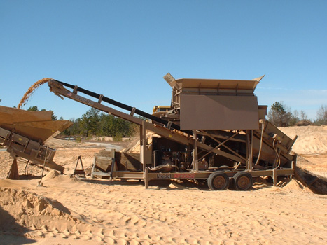 A CS2440 is teamed with a BF35D2 to tackle a sand operation