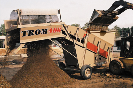 TROM406HM being loaded by a skidsteer